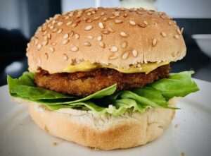Vivera Kroketburger on a hamburger bun with lettuce